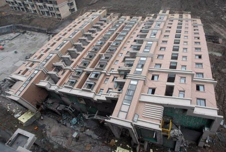 6a00d83451bdba69e20128763aba07970c 450wi A 12 story building topples over in China
