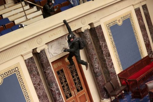 GettyImages 1294931398 1 500x333 'I got caught up in the moment': Man hanging from Senate balcony asks for forgiveness